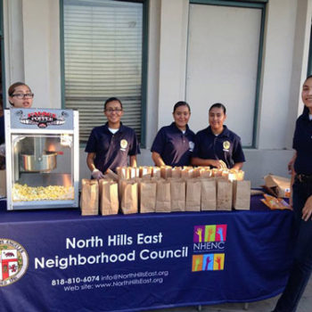 LAPD Cadettes serve popcorn at NHENC table