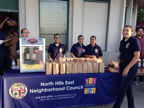 LAPD Cadettes serve popcorn at NHENC table