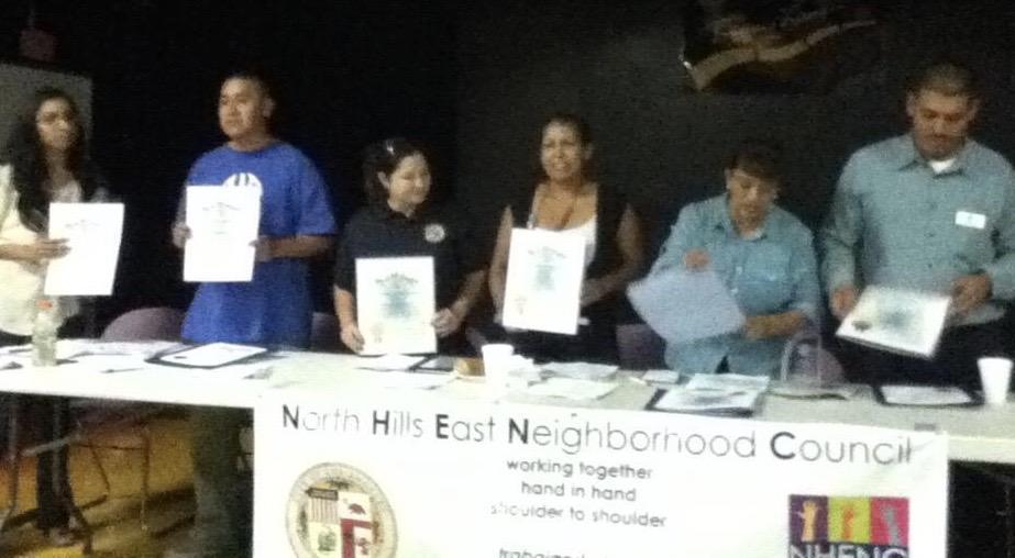 North Hills East Original Board holding certificates